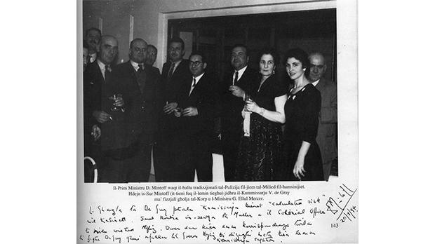 Mintoff (fifth from right) and Commissioner De Gray (eighth from right) at the Police Christmas ball in December 1956. (In handwriting below the image is Mintoff's declaration about the appointment of De Gray.)