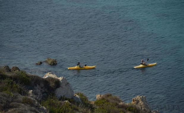 A pair of kayakers explore the coastline around Golden Bay on November 1. Photo: Matthew Mirabelli