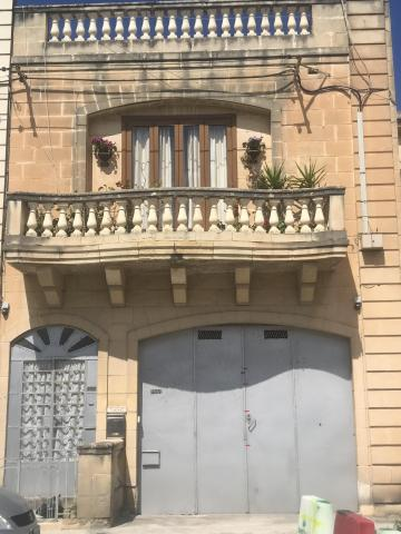 The family lived on a quiet residential road in Għaxaq.