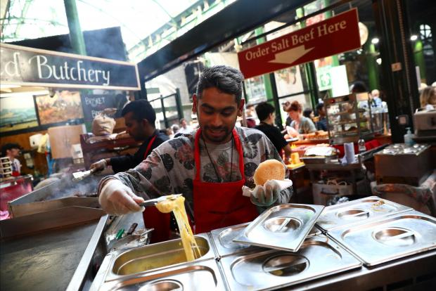 Life goes on at Borough Market in London. Photo: Reuters