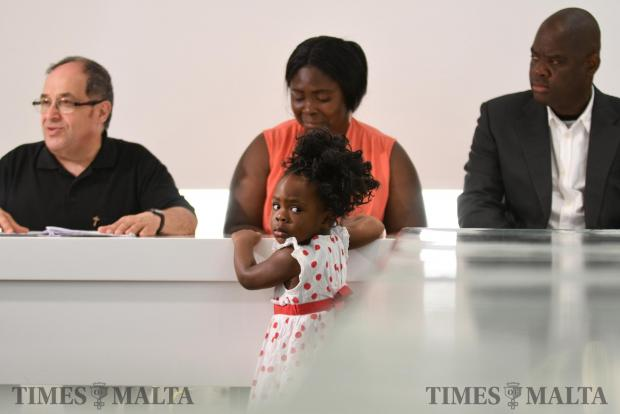 A father separated from his family during his rescue meets his daughter for first time on June 13. Photo: Jonathan Borg