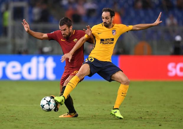 Roma's Kevin Strootman battles for the ball with Juanfran.