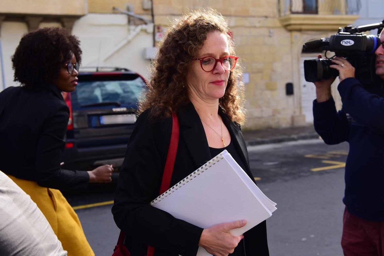 MEP Sophie in't Veld walks towards police headquarters, with MEP Assita Kanko behind her on the left.