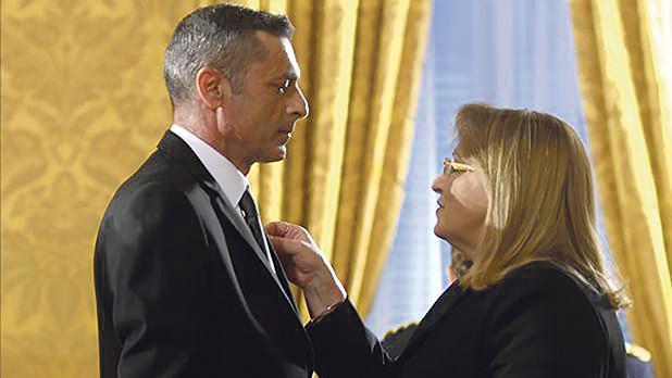 Simon Schembri being honoured with the Midalja għall-Qadi tar-Repubblika by then President Marie-Louise Coleiro Preca.