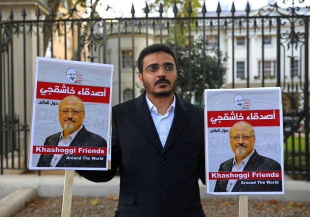 People protest against the killing of journalist Jamal Khashoggi in Turkey outside the Saudi Arabian Embassy in London.