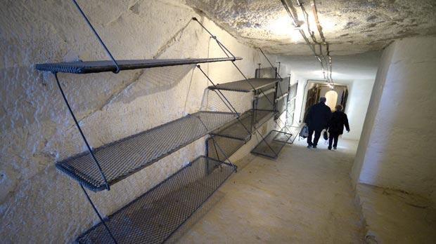 Foldable bunk beds in the communal dormitory in a tunnel passage which forms part of the counterguard.