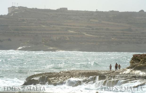 Bathers watch large waves crash on the shore in Marsascala on October 14. Photo: Matthew Mirabelli