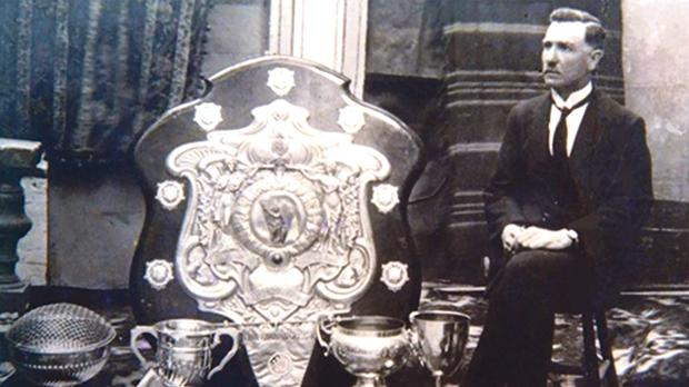 Joe Barbara, known as il-Mast, president of St George's Football Club, proudly sitting next to the Cousis Shield, 1927.