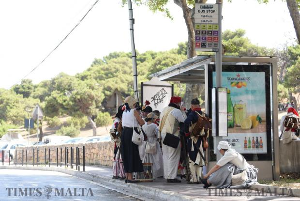 Re-enactors wait on a bus stop before a battle re-enactment in San Maison on June 5. Photo: Mark Zammit Cordina