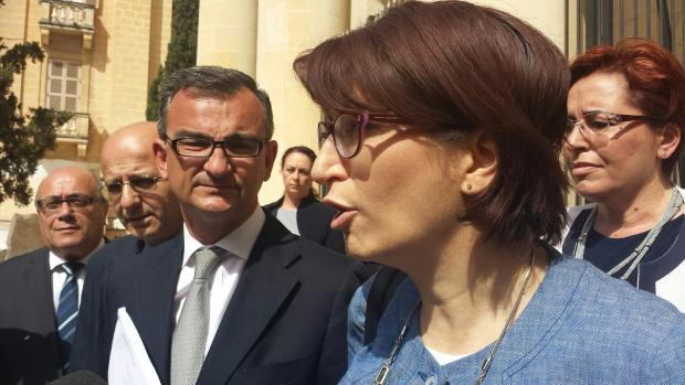 PN officials and lawyers addressing the press outside the courts.
