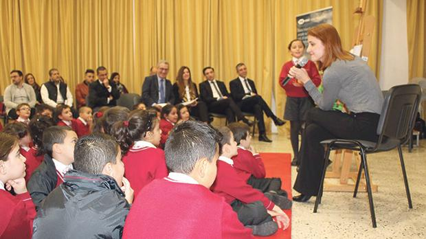 Mandy Zahra with pupils and guests during the book launch.
