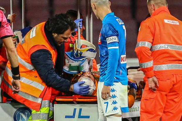 Napoli goalkeeper David Ospina is stretchered off after collapsing on Sunday.
