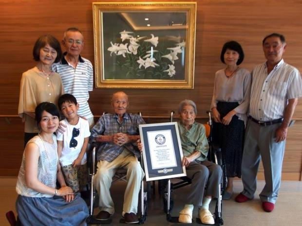 The couple with extended members of their family. Photo: Guinness Book of World Records