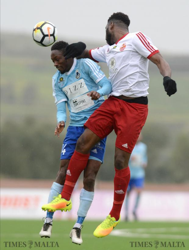 Sliema Wanderers Frank Temile (left) and Lija Athletic's Ousmane Sidibe, go head to head during their BOV Premier League match at the Centenary Football Stadium in Ta'Qali on February 3. Photo: Matthew Mirabelli