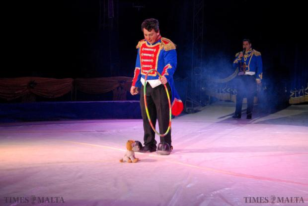 A clown from the Circo Viviana Orfei tries to get a soft toy of a lion to jump through a hoop during a performance at Manoel Island, Gzira on January 4. Photo Mark Zammit Cordina