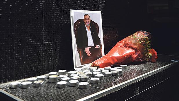 Flowers and candles placed in front of a photo of entrepreneur Hugo Chetcuti, who on Thursday succumbed to the injuries sustained when he was stabbed last week. Photos: Matthew Mirabelli