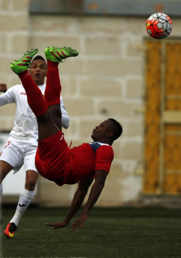 Pembroke's Sunday Eboh acrobatically clears the ball from Valletta's Jhonnattann during their Premier League football match at the Tedesco Stadium in Hamrun on December 3. Photo: Darrin Zammit Lupi