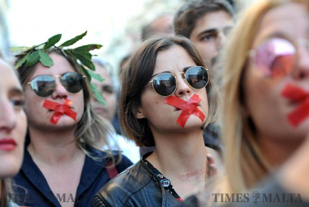 Protestors symbolically censor themselves with tape at the demonstration organised by the Civil Society Network in Sliema on October 29. The demonstration was organised in the wake of the assassination of Journalist Daphne Caruana Galizia 3 weeks ago. Photo: Chris Sant Fournier