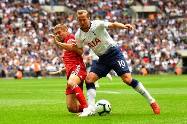 Harry Kane (right) is challenged by Fulham's Joe Bryan at Wembley Stadium.