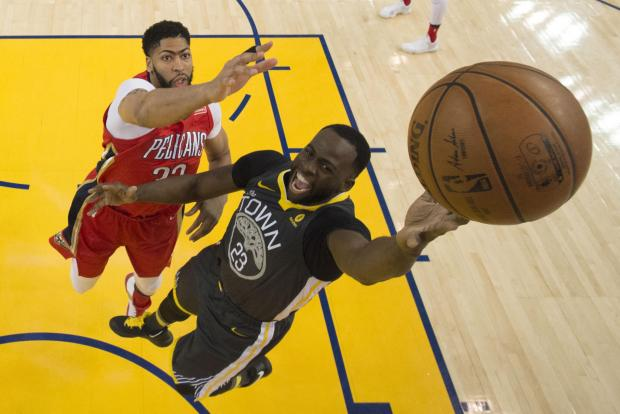Golden State Warriors forward Draymond Green (23) shoots the basketball against New Orleans Pelicans forward Anthony Davis (23) during the first half at Oracle Arena. The Pelicans defeated the Warriors 126-120. Photo Credit: Kyle Terada-USA TODAY Sports