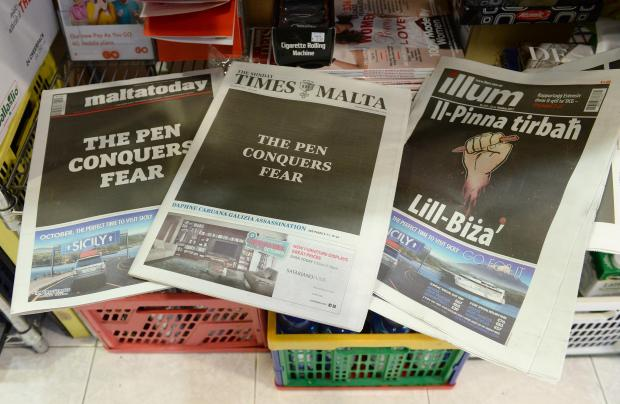Maltese newspapers' front pages read, 'The Pen Conquers Fear' on October 22, at a newsstand in Sliema as a common act of defiance following the murder of journalist Daphne Caruana Galizia on October 16. Photo: Matthew Mirabelli