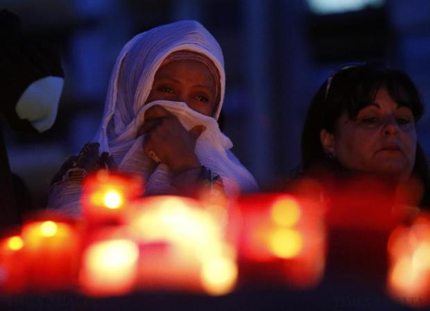 A migrant cries during a candlelight vigil to commemorate migrants who died at sea in Sliema on April 22. Public outrage over the deaths peaked this week after up to 800 migrants died last Sunday when their boat sank on its way to Europe from Libya. Photo: Darrin Zammit Lupi