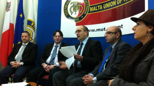 Mr Bonello (centre) speaking at the press conference.