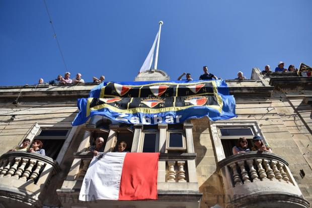 A large flag dangling from the roof of a house in Zabbar during a Nationalist Party Mass meeting on May 21. Photo: Mark Zammit Cordina