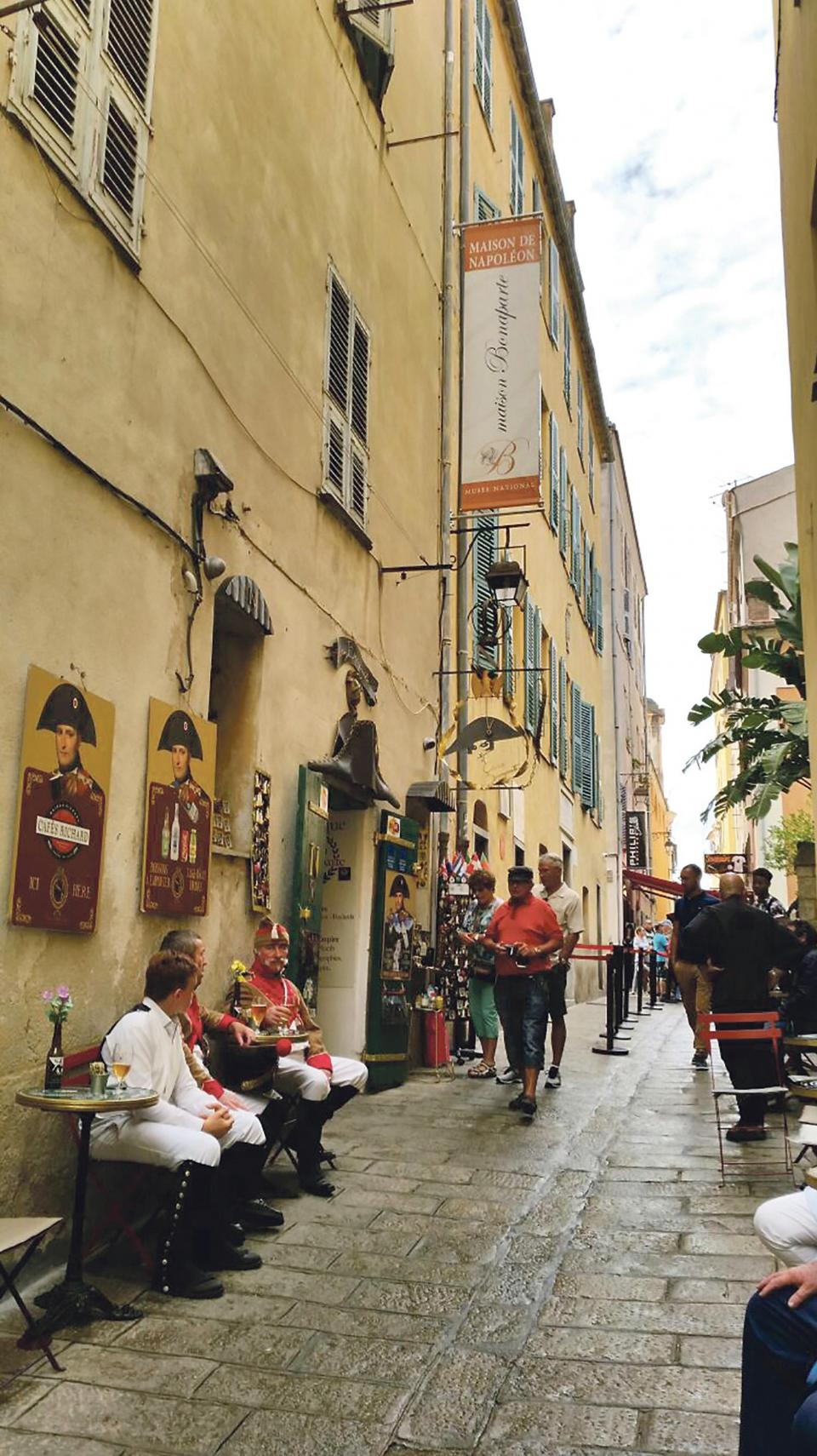 Rue St Charles in Ajaccio, capital of Corsica, showing the house where Napoleon Bonaparte was born on August 15, 1769, 250 years ago. Next door is Maison Bonaparte, a national museum, and a popular outlet selling Napoleonic paraphernalia and souvenirs.