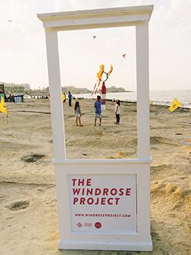 Kite-making workshop participants flying their kite during Winds Bring Gifts Ashore at Exiles Beach, Sliema.