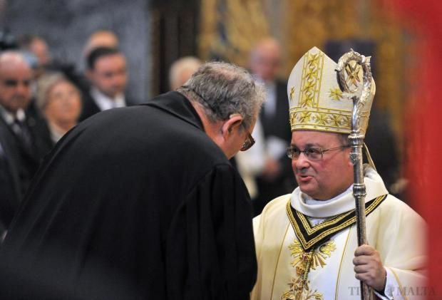 Grand Master Fra Matthew Festing shares a private moment with Archbishop Charles Scicluna at St John's Co-Cathedral on April 16. Photo: Jason Borg