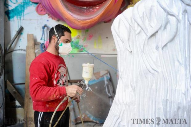 A carnival enthusiast sprays his float with white paint at Marsa ahead of Carnival celebrations next week on February 10 Photo: Steve Zammit Lupi