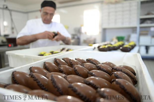 Easter eggs are lined up ready for decoration by 75-year-old Carmelo Borg Bonaci at Elia Caterers in Hamrun on March 2. Photo: Matthew Mirabelli
