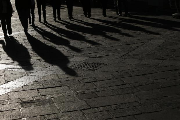 Tourists' shadows are cast on the pavement as they walk down Republic Street in Valletta on January 11. Photo: Darrin Zammit Lupi