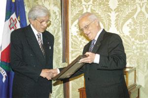 2005 file photo of then President Eddie Fenech Adami presenting the Europa Nostra award to Judge Maurice Caruana Curran. Photo: Jason Borg