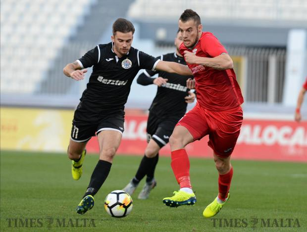 Hibernians Bjorn Kristensen, (left) tries to make his way past Balzan's Bojan Kaljevic during their BOV Premier League match at the National Stadium in Ta'Qali on December 9. Photo: Matthew Mirabelli