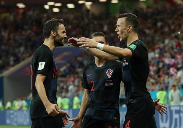 Croatia's Ivan Perisic celebrates scoring their second goal with Josip Pivaric and Milan Badelj.