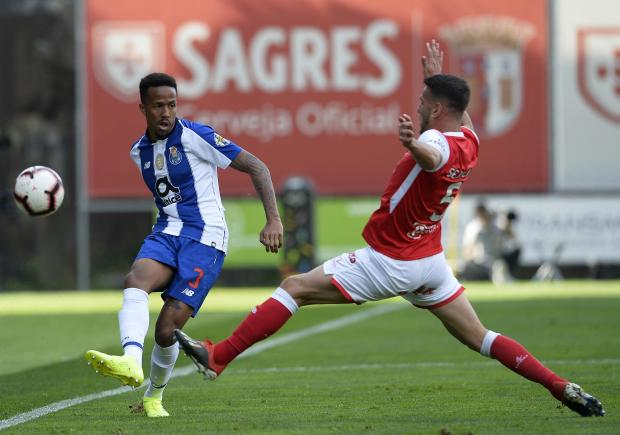 Porto's Eder Militao hits a pass past Nuno Sequeira, of Sporting Braga.