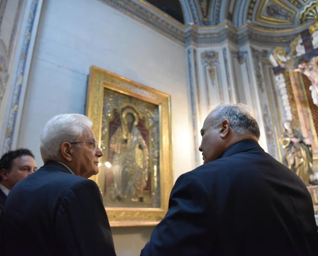 Italian President Sergio Mattarella views a painting at a cathedral in Mdina on September 14. Photo: Mark Zammit Cordina