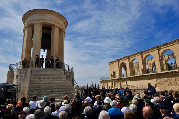 People attend the official ceremony to mark the 74th anniversary of the awarding of the George Cross to Malta at the Siege Bell War Memorial in Valletta on April 15. Photo: Steve Zammit Lupi