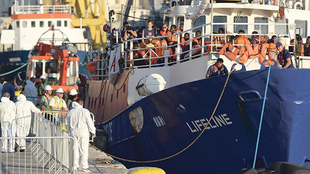 Migrants disembarking from the rescue vessel Lifeline in Grand Harbour last month.