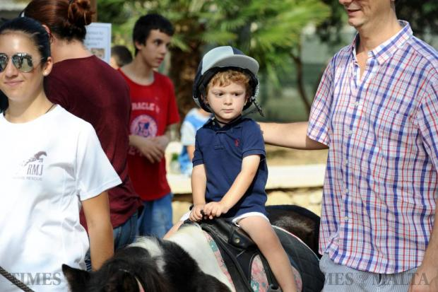 A young boy enjoys a ride at the open Animal Day at the Ghammieri Animal Centre on October 2. Photo: Steve Zammit Lupi