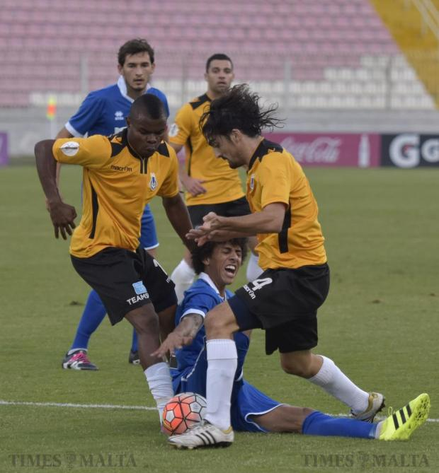 Sliema Wanderers' Solomon Wisdom (left) and Matthias Mucchardi stop Tarxien Rainbows' Emerson Marcellina during their Premier League football match at the National Stadium in Ta' Qali on September 25. Photo: Mark Zammit Cordina