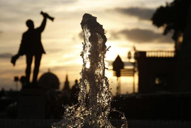 A fountain at Castille Place is backlit by the setting sun in Valletta on December 30. Photo: Darrin Zammit Lupi
