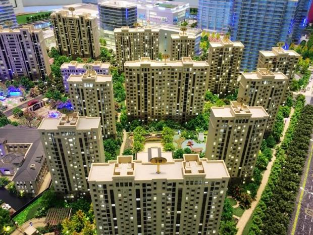 Models of a residential property project on display in Nanjing.