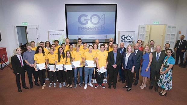 Students and researchers from the Faculty of Science who took part in the Go4Research internship programme, with (front row, sixth from right) Education Minister Evarist Bartolo, rector Alfred Vella, US Ambassador G. Kathleen Hill, Faculty of Science dean Charles Sammut, DLAP director Gaetano Bugeja and assistant director Desiree Scicluna Bugeja.