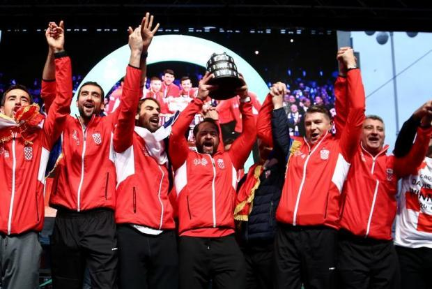 Croatia team captain Zeljko Kraja and team celebrate winning the 2018 Davis Cup.