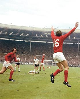 Martin Peters after scoring England's second goal in the 1966 World Cup final as team-mate Geoff Hurst (left) runs to congratulate him.