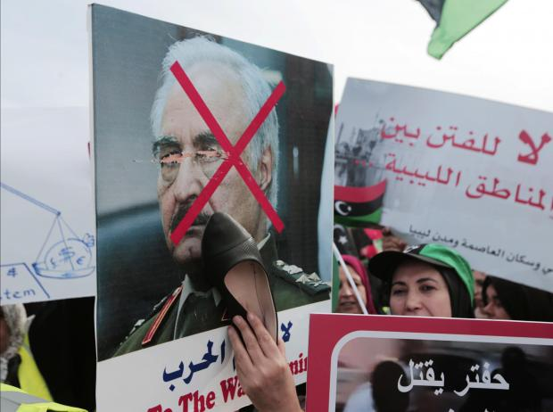 Protesters march in opposition to Haftar. Photo: AFP