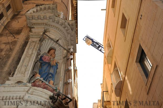 A religious effigy Our Lady adornes the corner of an apartment block in Valletta on March 1. Chris Sant Fournier